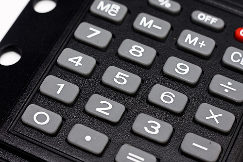 Gray electronic calculator buttons